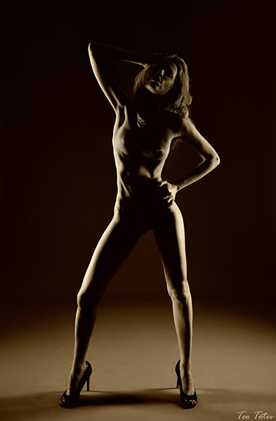 Nude photography and contrast lighting. Fine art photographer available.