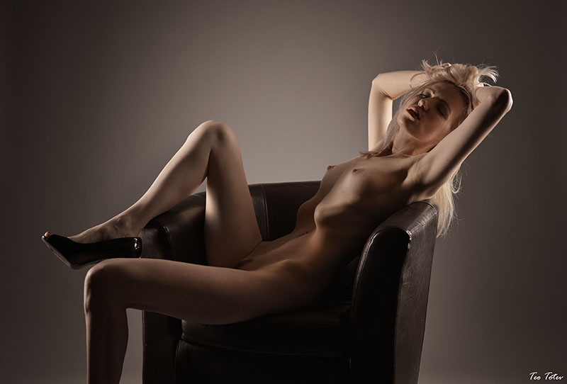 Skinny sexy girl in chair