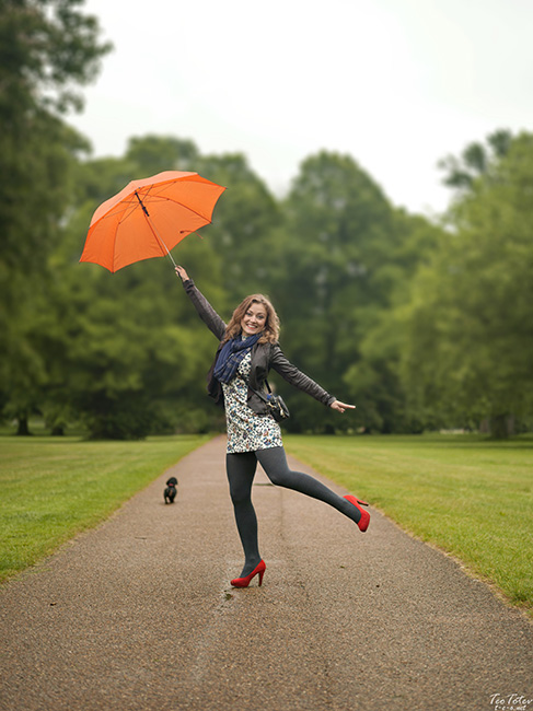 Photography in Rain with red umbrella