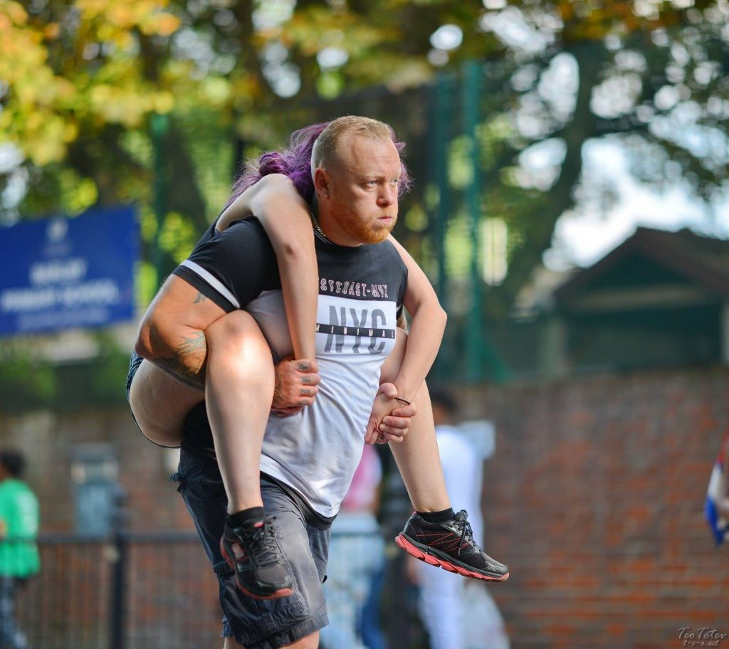 Carrying Wife on Back at Notting Hill Gate Festival
