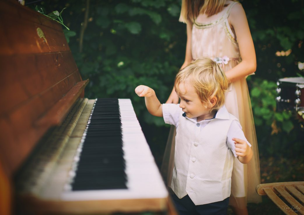 Child playing piano with one finger