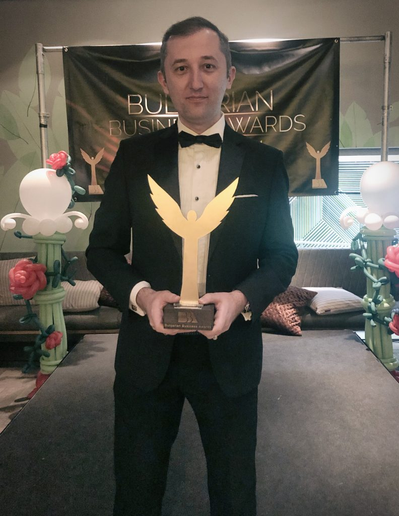 Happy Photographer with Award in Hand