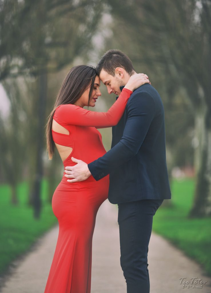 Pregnant couple touching heads